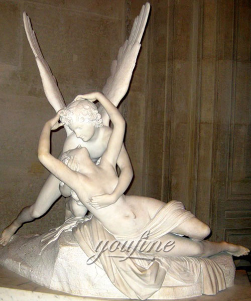 Outdoor marble statue of Psyche is received by Cupid's kiss