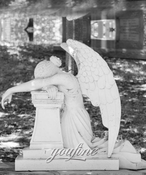 White marble weeping angel tombstone with memorial benches to buy
